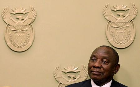 FILE PHOTO: President Cyril Ramaphosa watches as his new cabinet ministers are sworn in in Cape Town