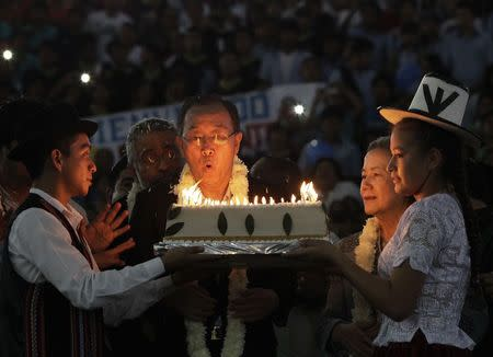 U.N. Secretary-General Ban blows the candles on a cake during a celebration for his 70th birthday in El Torno