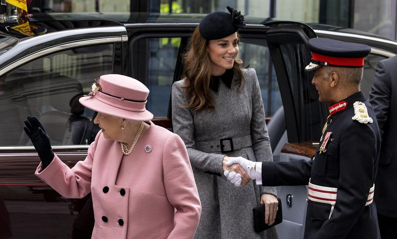 <p>The Duchess of Cambridge greets a member of the military upon arrival at Bush House. </p>