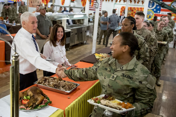 Vice President Mike Pence and his wife Karen Pence, second from left, serve turkey to troops at Al Asad Air Base, Iraq, Saturday, Nov. 23, 2019. The visit is Pence's first to Iraq and comes nearly one year since President Donald Trump's surprise visit to the country. (AP Photo/Andrew Harnik)