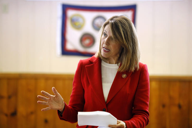 In this Nov. 11, 2019, photo, U.S. Rep. Cindy Axne, D-Iowa, speaks to local residents at the American Legion Post 184 in Winterset, Iowa. Axne defeated a Republican incumbent in 2018 even as she lost 15 of her district's 16 counties. Axne won by offsetting her losses in rural counties with an overwhelming victory in urban Polk County.  (AP Photo/Charlie Neibergall)