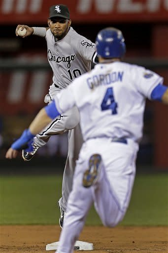 Chicago White Sox shortstop Alexei Ramirez (10) throws to first for the double play hit into by Kansas City Royals' Billy Butler after forcing Alex Gordon out at second during the third inning of a baseball game, Tuesday, Sept. 18, 2012, in Kansas City, Mo. (AP Photo/Charlie Riedel)