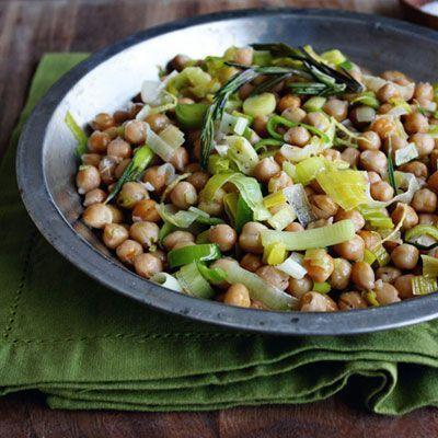 """<p>This simple, healthy dish is great as a side, or as a main dish stew over rice or your other favourite grain.</p><p>Get the <a href=""""https://www.delish.com/uk/cooking/recipes/a34584573/chickpeas-leeks-lemon-recipe-opr0213/"""" rel=""""nofollow noopener"""" target=""""_blank"""" data-ylk=""""slk:Chickpeas with Leeks and Lemon"""" class=""""link rapid-noclick-resp"""">Chickpeas with Leeks and Lemon</a> recipe.</p>"""