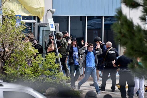 PHOTO: Students and teachers raise their arms as the exit the scene of a shooting in which at least seven students were injured at the STEM School Highlands Ranch, May 7, 2019, in Highlands Ranch, Colorado. (Tom Cooper/Getty Images, FILE)