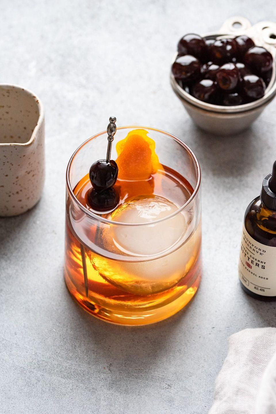 """<p>Give the original old fashioned cocktail an autumnal twist by adding maple syrup! If you want to go the extra mile, heat the orange peel to make a burnt orange garnish. </p><p><strong>Get the recipe at <a href=""""https://cookienameddesire.com/maple-old-fashioned/"""" rel=""""nofollow noopener"""" target=""""_blank"""" data-ylk=""""slk:A Cookie Named Desire"""" class=""""link rapid-noclick-resp"""">A Cookie Named Desire</a>. </strong></p><p><a class=""""link rapid-noclick-resp"""" href=""""https://go.redirectingat.com?id=74968X1596630&url=https%3A%2F%2Fwww.walmart.com%2Fsearch%2F%3Fquery%3Dtoothpicks&sref=https%3A%2F%2Fwww.thepioneerwoman.com%2Fholidays-celebrations%2Fg36982659%2Fhalloween-drink-recipes%2F"""" rel=""""nofollow noopener"""" target=""""_blank"""" data-ylk=""""slk:SHOP TOOTHPICKS"""">SHOP TOOTHPICKS</a></p>"""