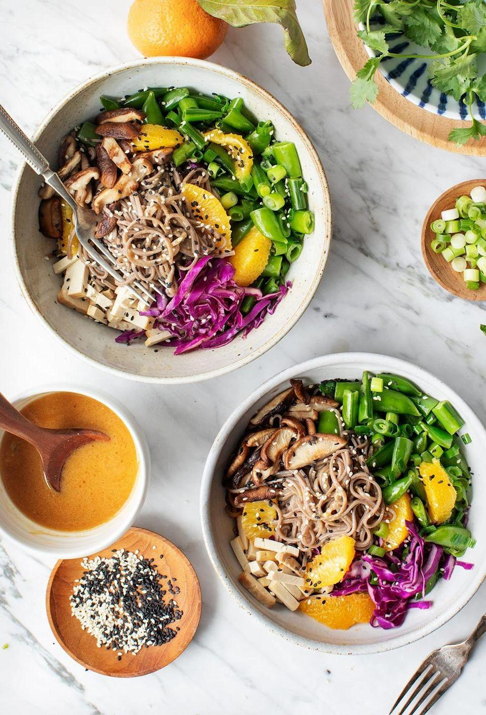 """<p>Soy sauce and mushrooms are a match made in umami heaven, while even more fresh elements make this refreshing lunch bowl a flavor powerhouse.</p><p><em><em><a href=""""https://www.loveandlemons.com/sesame-orange-noodle-bowl/"""" rel=""""nofollow noopener"""" target=""""_blank"""" data-ylk=""""slk:Get the recipe from Love and Lemons »"""" class=""""link rapid-noclick-resp"""">Get the recipe from Love and Lemons »</a></em></em> </p>"""