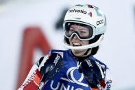 Switzerland's Michelle Gisin gets to the finish area after completing an alpine ski, women's World Cup slalom, in Semmering, Austria, Tuesday, Dec. 29, 2020. (AP Photo/Gabriele Facciotti)