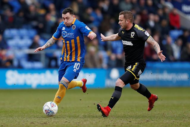 "Soccer Football - League One - Shrewsbury Town vs AFC Wimbledon - Montgomery Waters Meadow, Shrewsbury, Britain - March 24, 2018 Shrewsbury Town's Nathan Thomas in action with AFC Wimbledon's Dean Parrett Action Images/Ed Sykes EDITORIAL USE ONLY. No use with unauthorized audio, video, data, fixture lists, club/league logos or ""live"" services. Online in-match use limited to 75 images, no video emulation. No use in betting, games or single club/league/player publications. Please contact your account representative for further details."