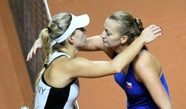 That was then: Petra Kvitova is congratulated by Angelique Kerber after their FedCup match at the weekend. On Wednesday, Kerber got revenge at the Stuttgart Grand Prix