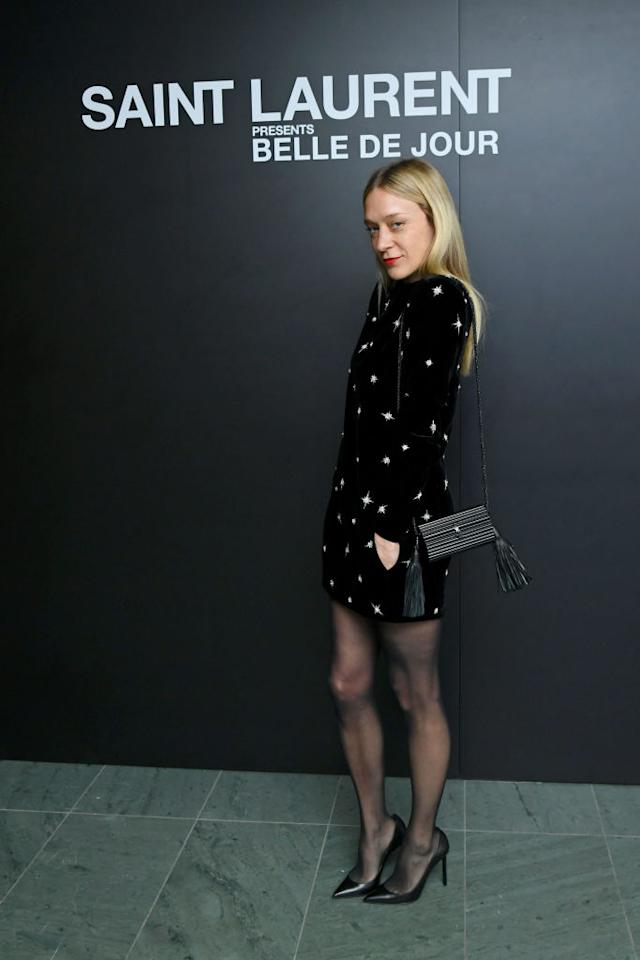 <p>Chloë Sevigny wore a chic mini dress and Saint Laurent bag for the star-studded bash. <em>[Photo: Getty]</em> </p>