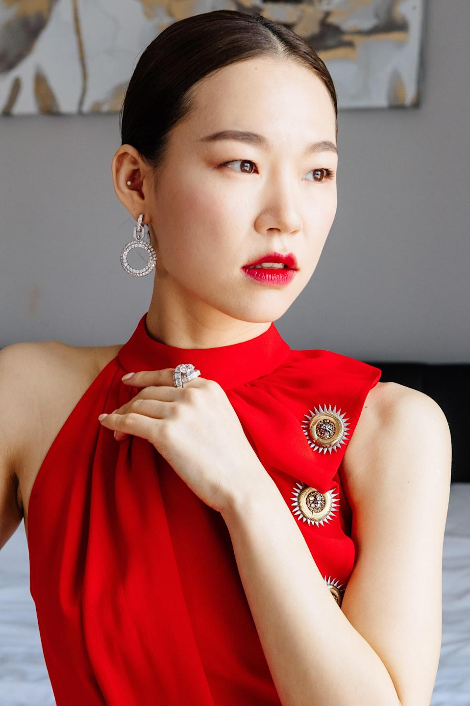 """""""It's very feminine, but holds strength at the same time,"""" says Han of her final beauty look. """"As red is fresh yet fierce, I tried to mix those two aspects together."""""""