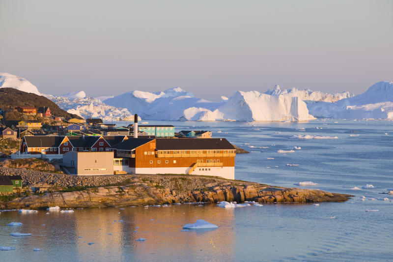 Colourful houses in Illulisat on Greenland Ilulissat is a UNESCO World Heritage Site because of the Jacobshavn Glacier or Sermeq Kujalleq which is the largest glacier outside Antarctica Photo: Ashley Cooper/Construction Photography/Avalon/Getty Images
