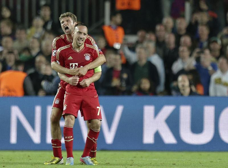 Bayern's Thomas Mueller, background, hugs team mate Bayern's Franck Ribery of France, at the end of the Champions League semifinal second leg soccer match between FC Barcelona and Bayern Munich at the Camp Nou stadium in Barcelona, Spain, Wednesday, May 1, 2013. (AP Photo/Matthias Schrader)