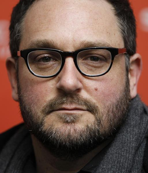 "FILE - In this Jan. 22, 2012 file photo, Director Colin Trevorrow poses at the premiere of ""Safety Not Guaranteed"" during the 2012 Sundance Film Festival in Park City, Utah. Trevorrow is taking the reins of ""Jurassic Park."" The 36-year-old director will helm ""Jurassic Park 4,"" Universal Pictures and Amblin Entertainment announced Thursday, March 14, 2013. (AP Photo/Danny Moloshok, File)"