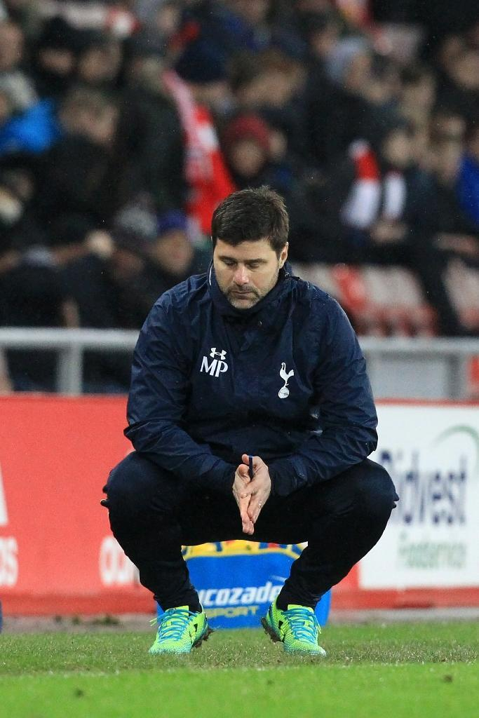 Mauricio Pochettino's Tottenham Hotspur are unbeaten in the English Premier League since mid-December, an 8-match run that has seen them take 20 of a possible 24 points to maintain their hopes of securing at the very least a top four finish in May (AFP Photo/Lindsey PARNABY)