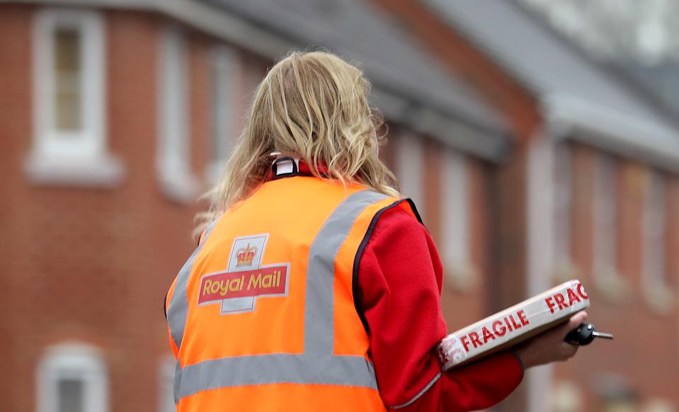 A Royal Mail delivery worker. Photo: Gareth Fuller/PA via Getty