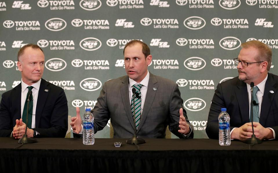 New York Jets new NFL football head coach Adam Gase, center, speaks while team owner Christopher Johnson, left, and general manager Mike Maccagnan look on during a news conference in Florham Park, N.J., Monday, Jan. 14, 2019. (AP Photo/Seth Wenig)
