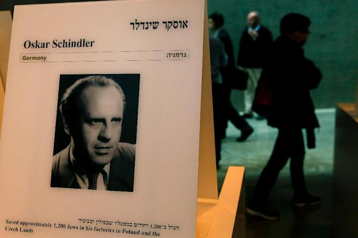 Visitors at the Yad Vashem Holocaust museum in Jerusalem walk past a portrait of Oskar Schindler, who saved some 1,200 Jews from the Nazis during World War II (AFP Photo/Gali Tibbon)