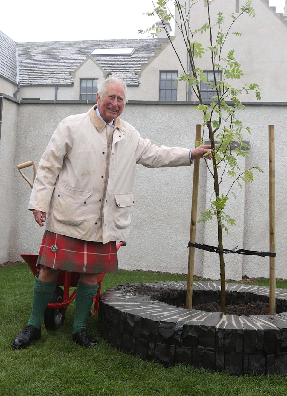 <p>Prince Charles takes a tour of the newly restored House of the Northern Gate and its gardens during a visit to Thurso, Scotland, on July 29.</p>