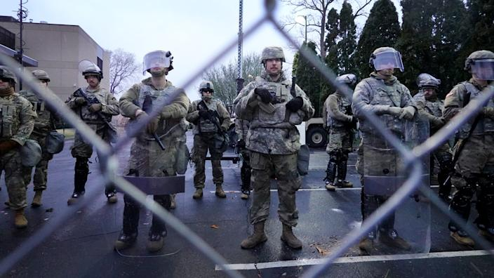 National Guard soldiers and police protect the Brooklyn Center Police station as demonstrators protest the shooting death of Daunte Wright on April 13, 2021 in Brooklyn Center, Minnesota. (Scott Olson/Getty Images)