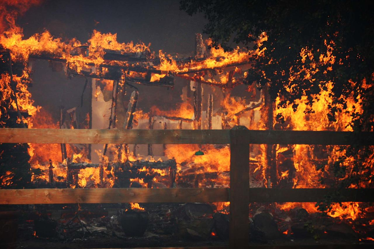Multiple structures burn in the Poppet Flats area as the Silver Fire roared through the area along Hwy 243 between Banning and Idyllwild, Calif. on Wednesday, Aug. 7, 2013. (AP Photo/The Press-Enterprise, Frank Bellino)