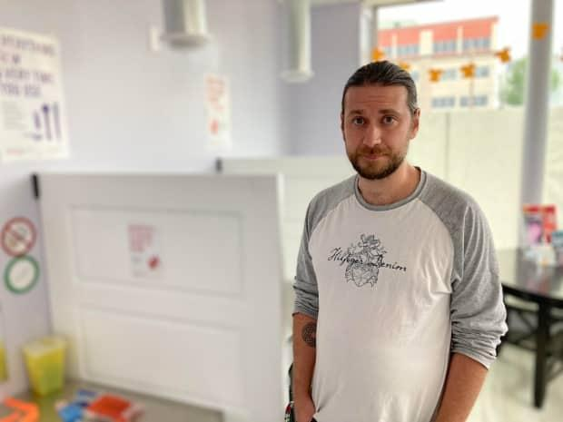 Michael Parker stands inside the Nēwo Yōtina Friendship Centre, which now has rapid testing which can detect potent drugs that may be unknowingly laced into other substances and reduce dangerous overdoses in the community.  (Matt Duguid/CBC News - image credit)