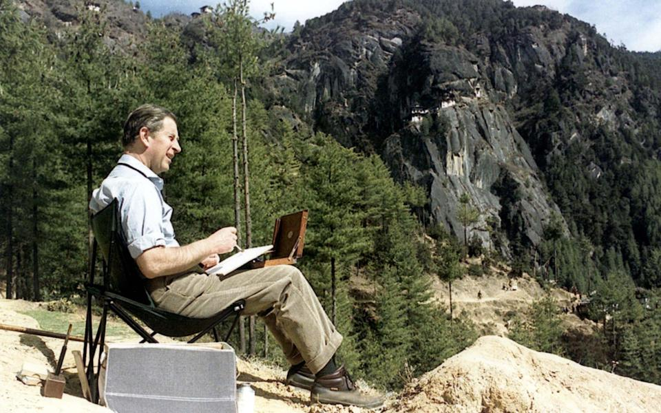 Prince Charles painting a watercolour in the Bhutan Himalayas - Alpha Photo