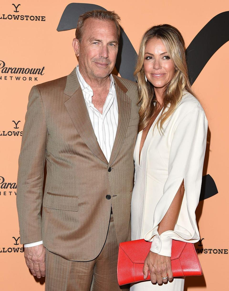 """<p><strong>Age gap:</strong> 20 years </p><p>Kevin, 65, and Christine, 45, <a href=""""https://www.goodhousekeeping.com/life/entertainment/a28447513/kevin-costner-wife-christine-baumgartner/"""" rel=""""nofollow noopener"""" target=""""_blank"""" data-ylk=""""slk:have been married since 2004"""" class=""""link rapid-noclick-resp"""">have been married since 2004</a>. The couple briefly broke up before their marriage after Kevin said he didn't want more kids (he already had four from previous relationships). He eventually changed his mind and the pair had three children together, making him a father of seven. </p>"""