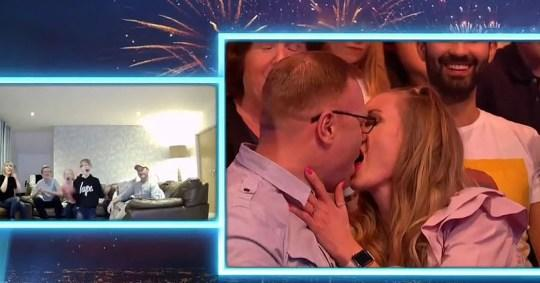 'Saturday Night Takeaway' audience members Rob and Annette shared a snog to make their kids cringe. (ITV)