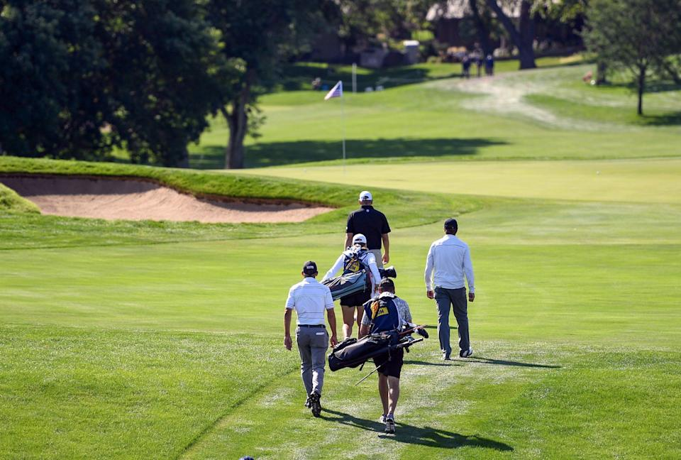 Jay Jurecic, lower left, walks down the fairway with the other members of his group during the first day of the Sanford International golf tournament on Friday, September 17, 2021, at the Minnehaha Country Club in Sioux Falls. Erin Bormett / Argus Leader