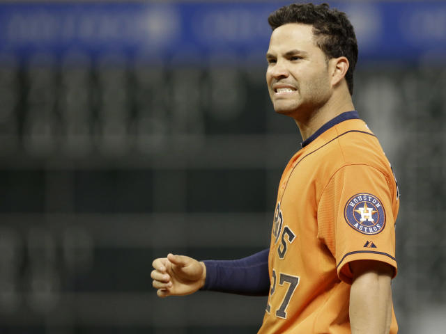 Houston Astros' Jose Altuve grimaces after grounding out to end the eighth inning of a baseball game against the Oakland Athletics Friday, April 25, 2014, in Houston. (AP Photo/Pat Sullivan)
