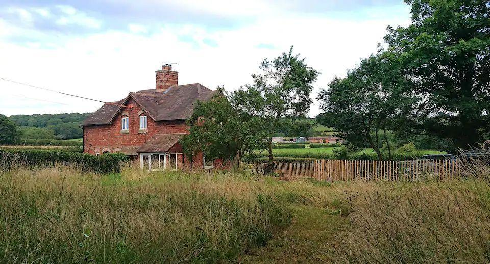 """<p>This dog-friendly Airbnb is a semi-detatched farm cottage in the Shropshire Hills. Set in lovely Corvedale, it's located on a working sheep and arable farm. Inside, the space is cosy, with plenty of room for dog beds, <a href=""""https://www.countryliving.com/uk/travel-ideas/staycation-uk/a34093927/best-hiking-boots/"""" rel=""""nofollow noopener"""" target=""""_blank"""" data-ylk=""""slk:walking boots"""" class=""""link rapid-noclick-resp"""">walking boots</a> and wellies. The large fenced garden with private meadow is ideal for dogs to explore and when you want to go beyond the cottage, there's a 20-minute round walk on the farm by the River Corve.<strong><br></strong></p><p><strong>Sleeps: </strong>4</p><p><strong>Price per night: </strong>£90</p><p><a class=""""link rapid-noclick-resp"""" href=""""https://airbnb.pvxt.net/jWWNvv"""" rel=""""nofollow noopener"""" target=""""_blank"""" data-ylk=""""slk:SEE INSIDE"""">SEE INSIDE</a></p>"""