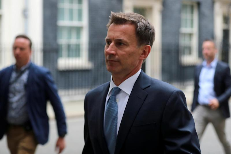Foreign Secretary Jeremy Hunt is seen outside Downing Street (REUTERS)