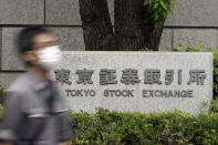 A man walks by the Tokyo Stock Exchange building Thursday, Oct. 1, 2020, in Tokyo. Trading on the Tokyo Stock Exchange was suspended Thursday because of a problem in the system for relaying market information. (AP Photo/Eugene Hoshiko)