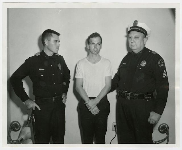 <p>Lee Harvey Oswald, accused of assassinating former President John F. Kennedy, is pictured with Dallas police Sgt. Warren, right, and a fellow officer in Dallas, in this handout image taken on Nov. 22, 1963. (Photo: Dallas Police Department/Dallas Municipal Archives/University of North Texas/Handout/Reuters) </p>