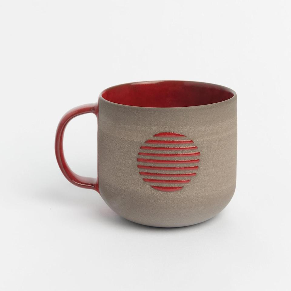 """<h3><h2>Jasmins Clay Works Stoneware Mug</h2></h3><br><strong>Under $50</strong><br>This subtle, elevated stoneware mug will make an elegant addition to your dad's mug collection.<br><br><em>Shop Jasmins Clay Works on <strong><a href=""""https://www.etsy.com/shop/JasminsClayWorks"""" rel=""""nofollow noopener"""" target=""""_blank"""" data-ylk=""""slk:Etsy"""" class=""""link rapid-noclick-resp"""">Etsy</a></strong></em><br><br><strong>Jasmins Clay Works</strong> Handmade Stoneware Mug, $, available at <a href=""""https://go.skimresources.com/?id=30283X879131&url=https%3A%2F%2Fwww.etsy.com%2Flisting%2F904432194%2Fhandmade-stoneware-mug-red-or-yellow"""" rel=""""nofollow noopener"""" target=""""_blank"""" data-ylk=""""slk:Etsy"""" class=""""link rapid-noclick-resp"""">Etsy</a>"""