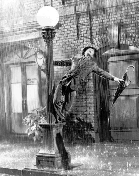 """FILE - In this undated file photo, Gene Kelly performs in the 1952 film """"Singin' in the Rain."""" The grey wool suit was purchased Thursday, Dec. 12, 2013, by the theme restaurant Planet Hollywood International for more than $106,000. Kelly wore the suit for the soggy featured dance in the 1952 movie musical. (AP Photo/LM Otero)"""