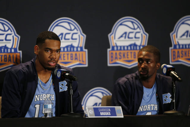 North Carolina player Garrison Brooks, left, answers a question as teammate Brandon Robinson looks on during the Atlantic Coast Conference NCAA college basketball media day in Charlotte, N.C., Tuesday, Oct. 8, 2019. (AP Photo/Nell Redmond)