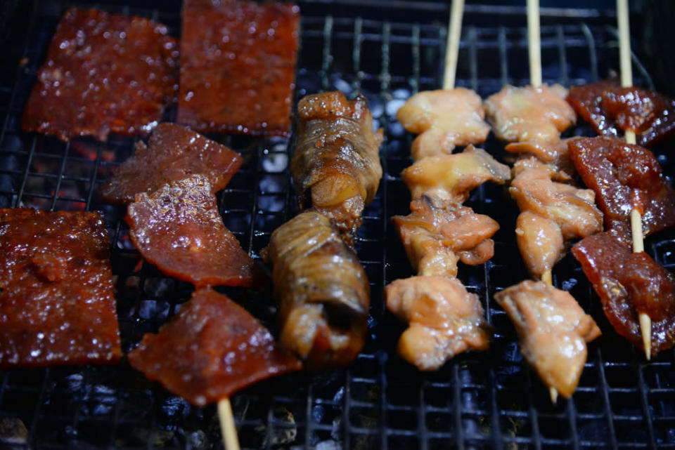 (From left) Bak Kua, Bak Kua stick, Zha Ti and bishop's nose grilling under the small griller.