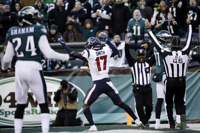 Houston Texans' Vyncint Smith celebrates after scoring a touchdown during the second half of an NFL football game against the Philadelphia Eagles, Sunday, Dec. 23, 2018, in Philadelphia. (AP Photo/Matt Rourke)
