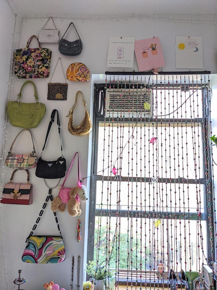 a wall with purses hung on it