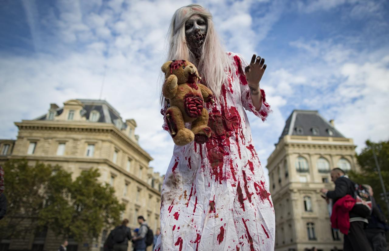 <p>Participants in costume walk in World Zombie Day 2017 event on Place de la République in Paris, France, Oct. 7, 2017. (Photo: EFE/EPA/IAN LANGSDON) </p>