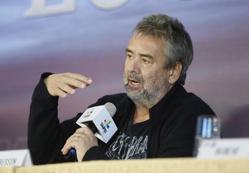 """Director Luc Besson talks to media after finishing parts of his filming in Taiwan for a new movie """"Lucy"""" in Taipei, Taiwan, Friday, Nov. 1, 2013. Besson slammed paparazzi in Taiwan for interfering with the shooting but denied reports that he considered leaving the island early to underscore his disgust over their actions. (AP Photo/Wally Santana)"""