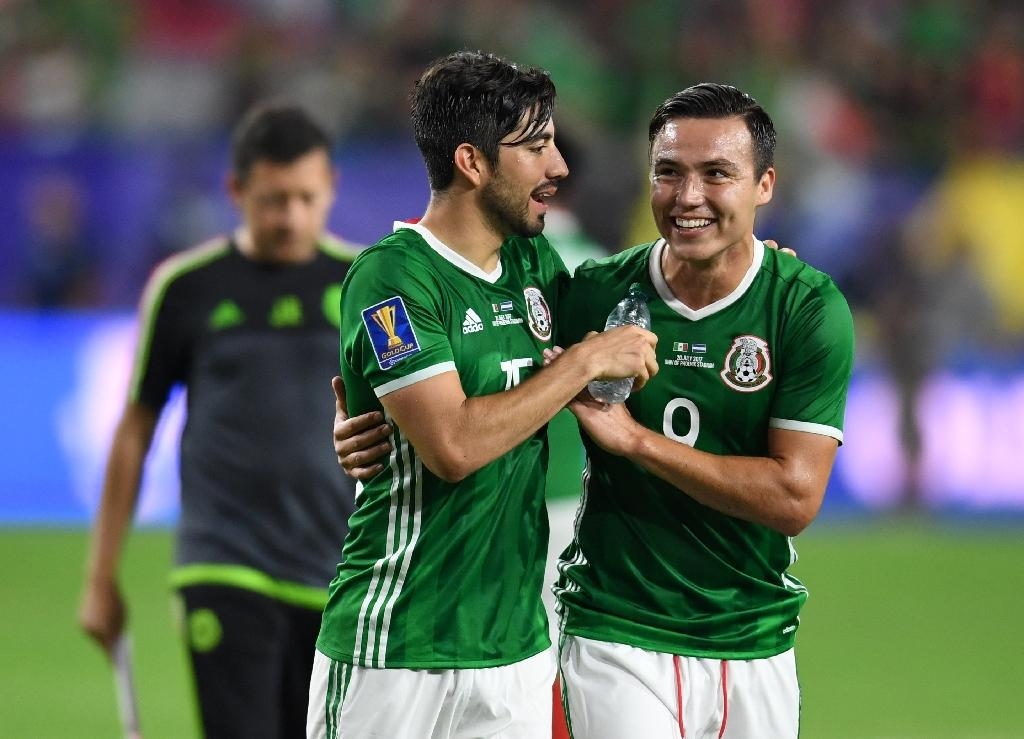 Mexico's Rodolfo Pizarro (L) and Erick Torres celebrate their 1-0 victory over Honduras in the CONCACAF Gold Cup quarter-final match, at the University of Phoenix Stadium in Glendale, Arizona, on July 20, 2017 (AFP Photo/Robyn Beck)