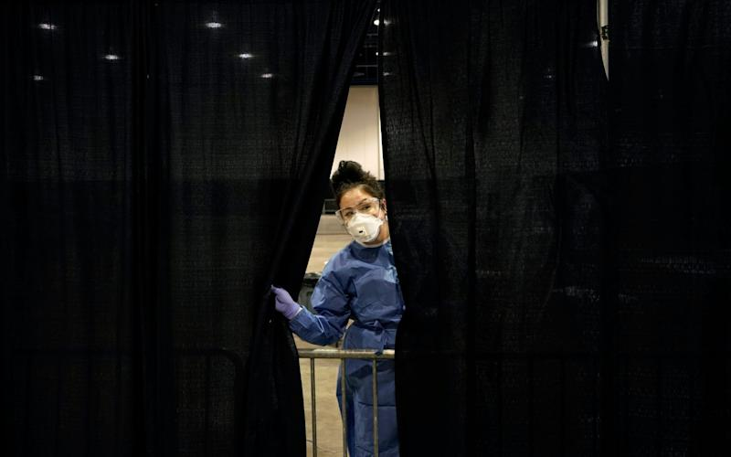 A coronavirus testing site in Las Vegas, Nevada. Residents in the state will be encouraged to post their votes - AP