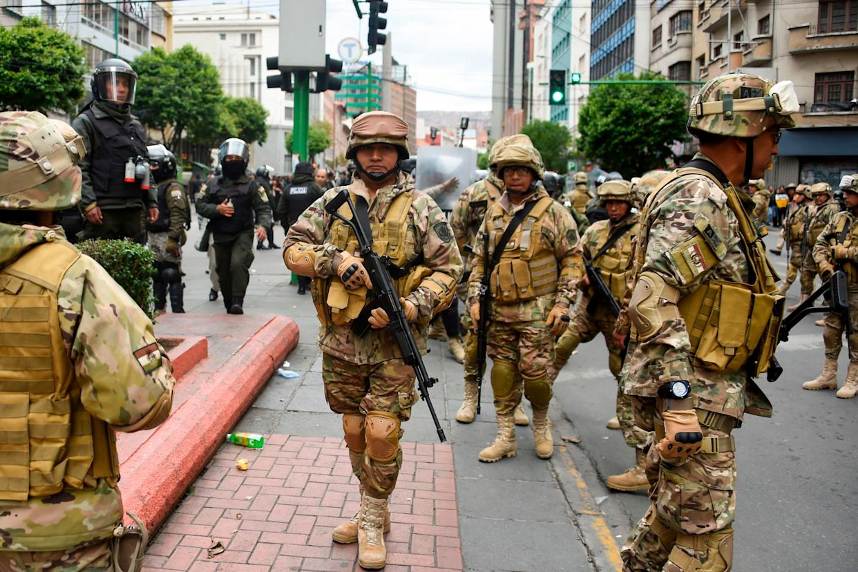 Militarized Bolivian police stand guard as supporters of Evo Morales demonstrate in La Paz on Nov.14, 2019. (Photo: AIZAR RALDES via Getty Images)