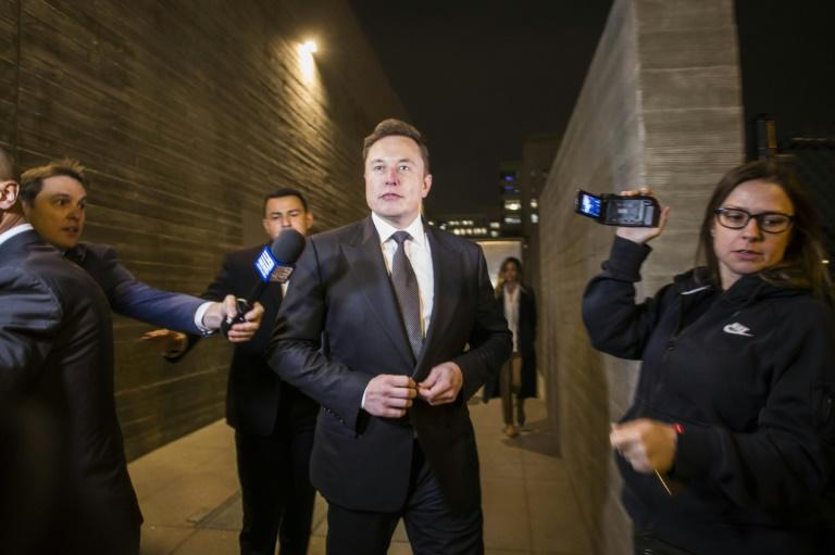 Tesla co-founder Elon Musk leaves the Los Angeles federal courthouse through a back door on December 3, 2019