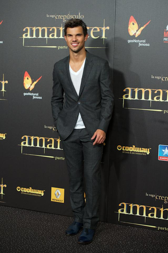 "MADRID, SPAIN - NOVEMBER 15:  Actor Taylor Lautner attends the ""The Twilight Saga: Breaking Dawn - Part 2"" (La Saga Crepusculo: Amanecer Parte 2) premiere at the Kinepolis cinema on November 15, 2012 in Madrid, Spain.  (Photo by Carlos Alvarez/Getty Images)"