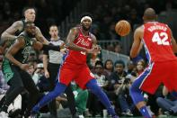 Philadelphia 76ers' Joel Embiid (21) passes to Al Horford (42) as Boston Celtics' Jaylen Brown (7) and Daniel Theis, back left, defend during the first half of an NBA basketball game in Boston, Saturday, Feb. 1, 2020. (AP Photo/Michael Dwyer)
