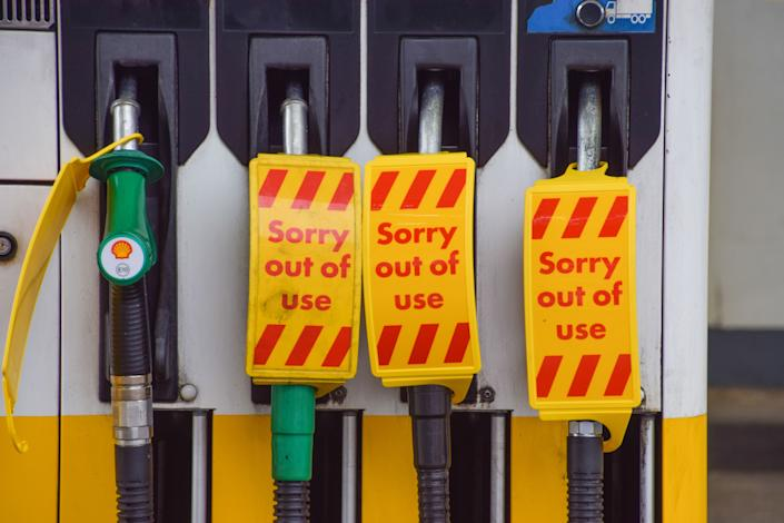 LONDON, UNITED KINGDOM - 2021/10/03: 'Sorry, Out Of Use' signs cover the petrol pumps at a Shell station in Islington.  Many UK stations have run out of petrol due to a shortage of truck drivers linked to Brexit, along with panic buying. (Photo by Vuk Valcic/SOPA Images/LightRocket via Getty Images)